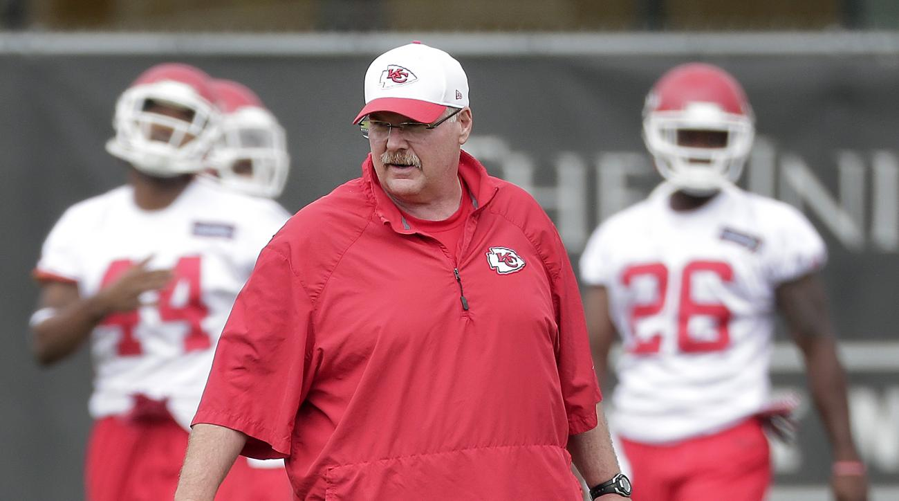 Kansas City Chiefs coach Andy Reid watches a drill during an NFL football organized team activity, Thursday, June 11, 2015, in Kansas City, Mo. (AP Photo/Charlie Riedel)