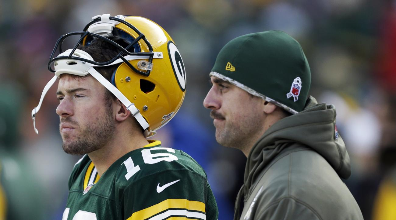 FILE - In this Nov. 10, 2013, file photo, Green Bay Packers' Aaron Rodgers and Scott Tolzien watch from the sidelines during the second half of an NFL football game against the Philadelphia Eagles in Green Bay, Wis. Offseason workouts will be important fo