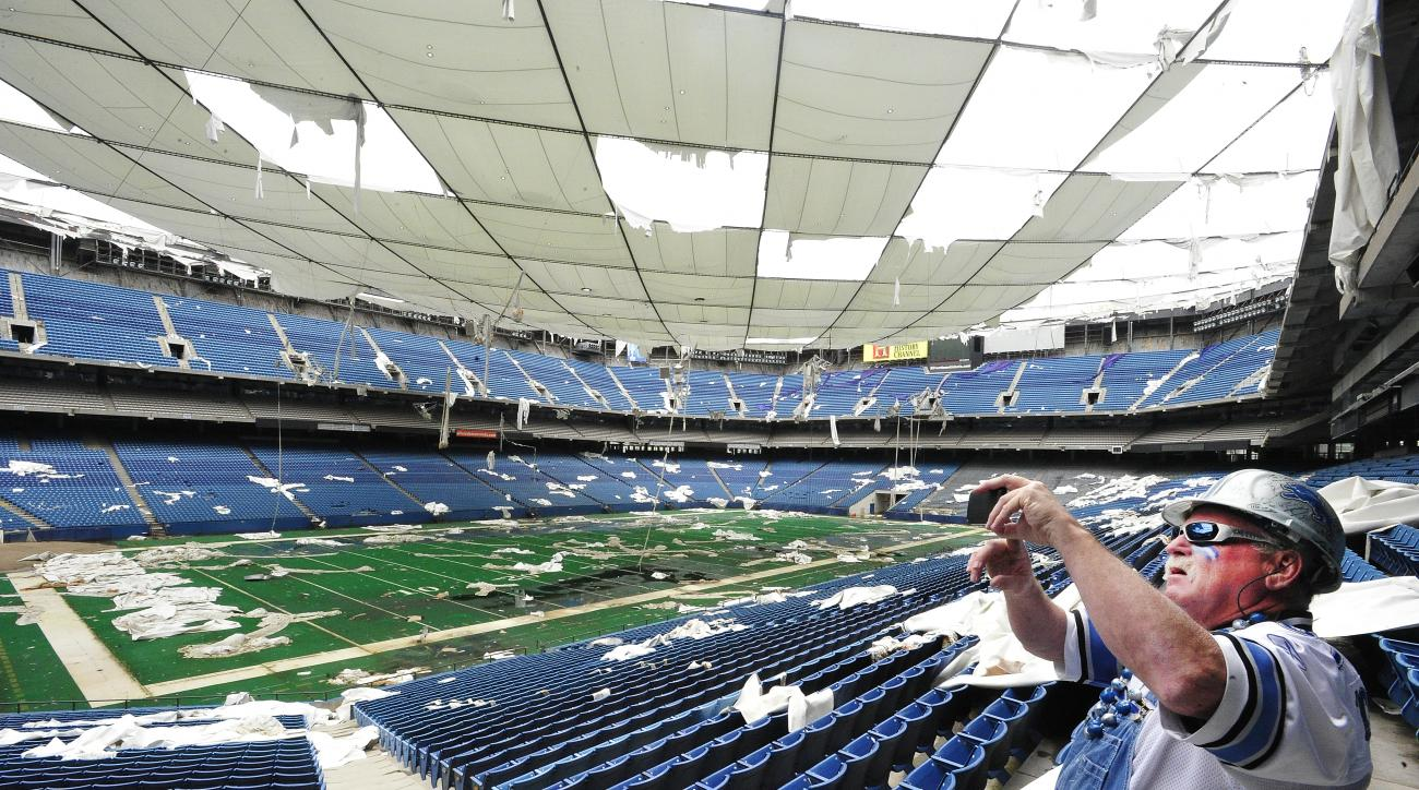 "FILE - In this May 12, 2014 file photo,   Ron ""Crackman"" Crachiola takes a picture on his cell phone at the Pontiac Silverdome in Pontiac,  Mich.  The Pontiac Silverdome is up for sale again, with an asking price of about $30 million. The former home of t"