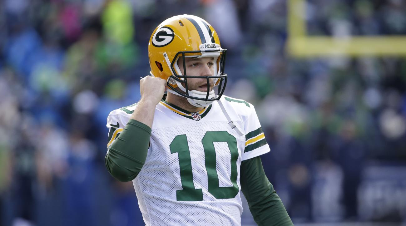 Green Bay Packers quarterback Matt Flynn (10) warms up before the NFL football NFC Championship game against the Seattle Seahawks Sunday, Jan. 18, 2015, in Seattle. (AP Photo/Elaine Thompson)