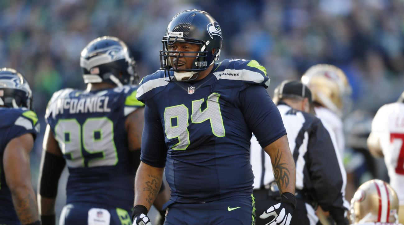 Seattle Seahawks' Kevin Williams reacts after a play against the San Francisco 49ers in the first half of an NFL football game, Sunday, Dec. 14, 2014, in Seattle. (AP Photo/John Froschauer)