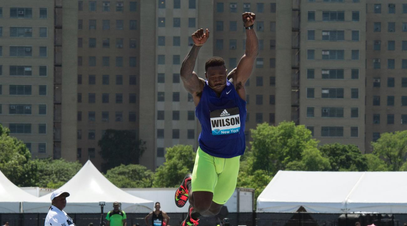 Former NY Giant David Wilson competes in the triple jump at the Adidas Grand Prix, Saturday, June 13, 2015 in New York. (AP Photo/Bryan R, Smith)