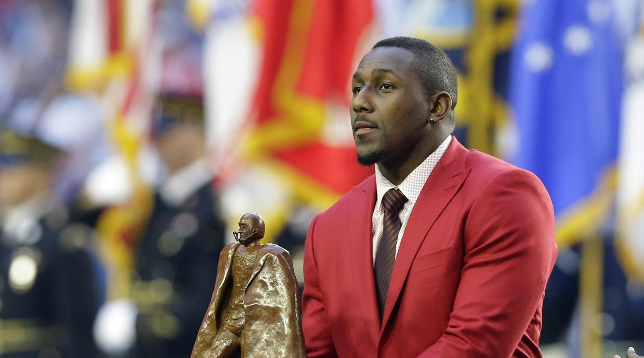 Carolina Panthers linebacker Thomas Davis is honored as the Walter Payton Man of the Year award winner before the NFL Super Bowl XLIX football game between the Seattle Seahawks and the New England Patriots Sunday, Feb. 1, 2015, in Glendale, Ariz. (AP Phot