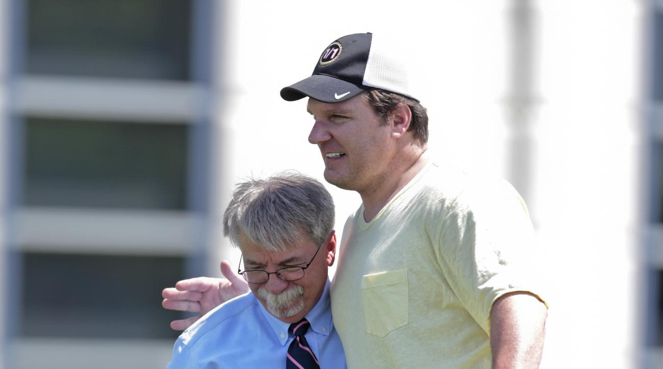 Tennesse Titans interim president Steve Underwood, left, gets a hug from former Titans tight end Frank Wycheck during NFL football minicamp , Tuesday, June 16, 2015, in Nashville, Tenn. The Titans announced Tuesday that Underwood, who currently serves as