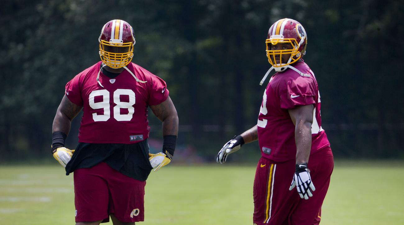 Washington Redskins Terrance Knighton (98) and Chris Baker (92) take part in drills during NFL football minicamp at Redskins Park Tuesday, June 16, 2015 in Ashburn, Va. (AP Photo/Pablo Martinez Monsivais)