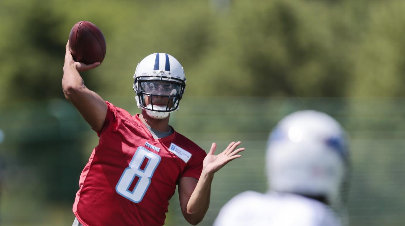Tennessee Titans quarterback Marcus Mariota (8) passes during NFL football minicamp on Tuesday, June 16, 2015, in Nashville, Tenn. (AP Photo/Mark Humphrey)