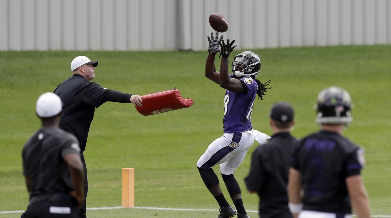 Baltimore Ravens wide receiver Breshad Perriman catches a pass at an NFL football minicamp practice, Tuesday, June 16, 2015, in Owings Mills, Md. (AP Photo/Patrick Semansky)