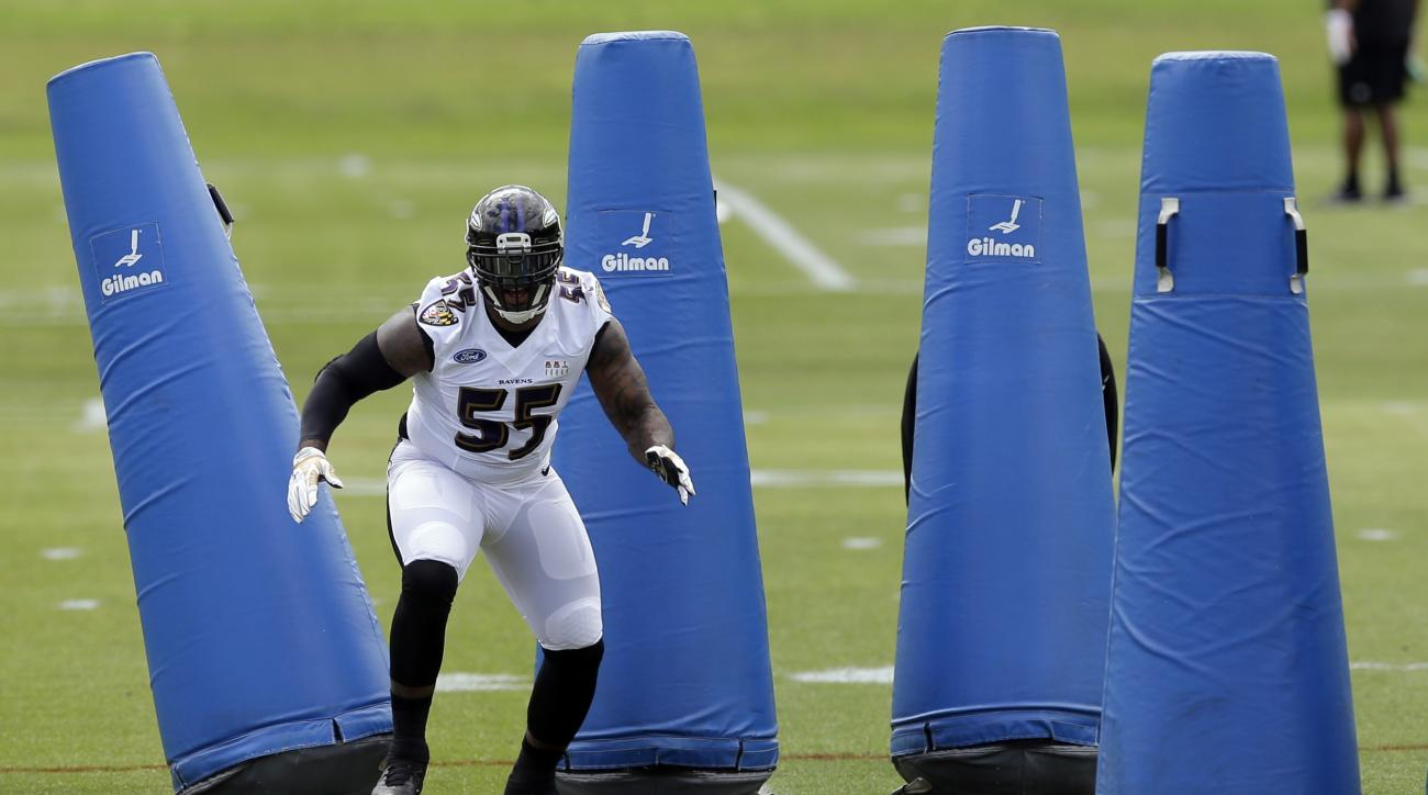 Baltimore Ravens linebacker Terrell Suggs runs a drill at an NFL football minicamp practice, Tuesday, June 16, 2015, in Owings Mills, Md. (AP Photo/Patrick Semansky)