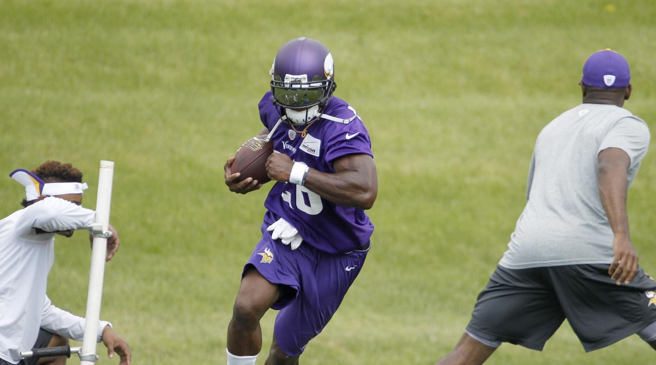 Minnesota Vikings running back Adrian Peterson takes part in a drill during NFL football minicamp in Eden Prairie, Minn., Wednesday, June 17, 2015. (AP Photo/Ann Heisenfelt