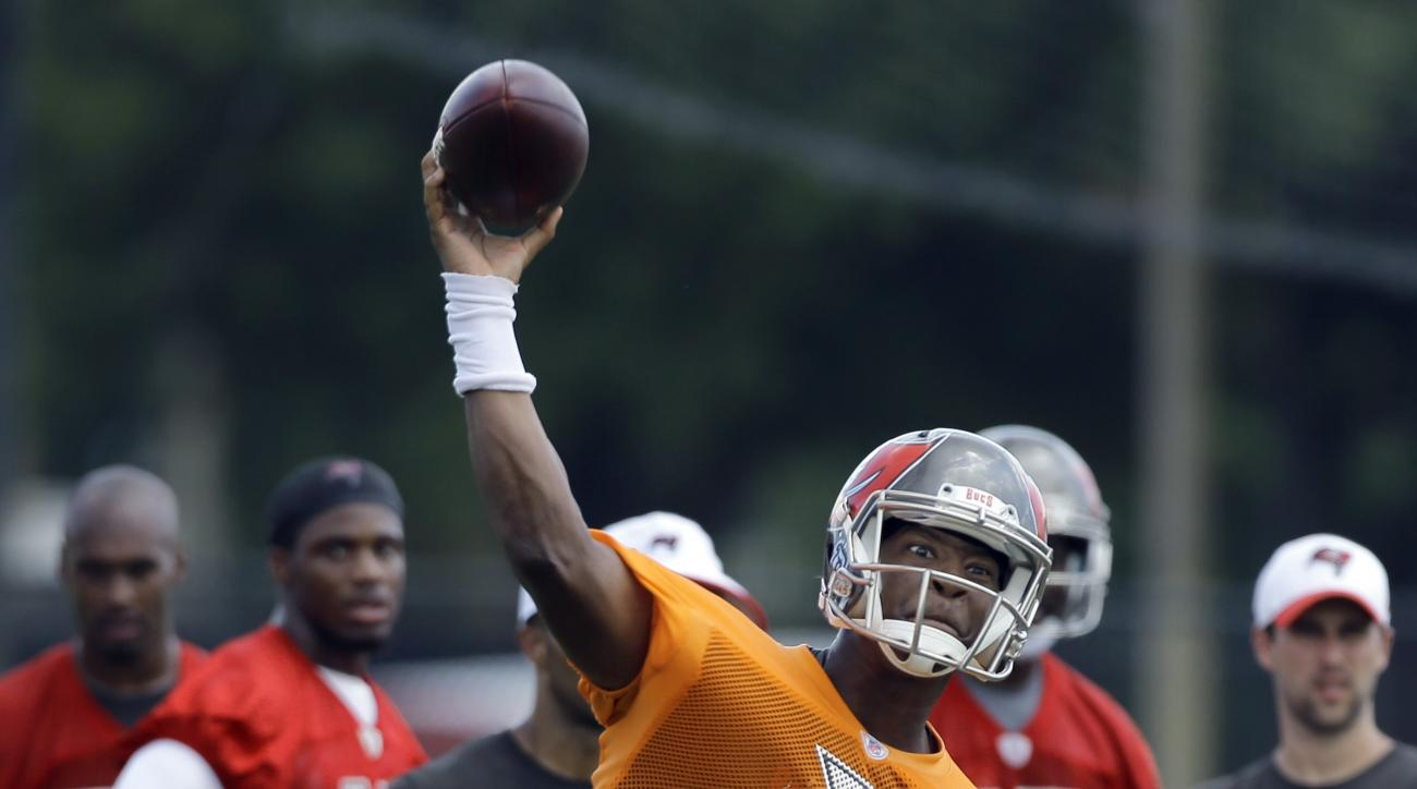 Tampa Bay Buccaneers quarterback Jameis Winston (3) throws a pass during NFL football minicamp, Wednesday, June 17, 2015, in Tampa, Fla. (AP Photo/Chris O'Meara)
