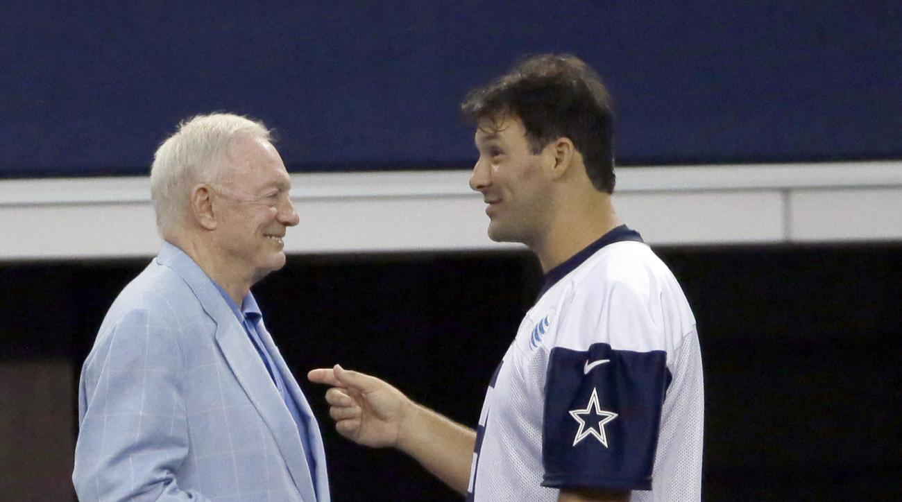 Dallas Cowboys quarterback Tony Romo, right, and owner Jerry Jones chat on the sideline during an NFL football minicamp at the team's stadium in Arlington, Texas, Wednesday, June 17, 2015.  (AP Photo/LM Otero)