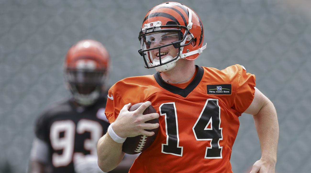 Cincinnati Bengals quarterback Andy Dalton runs a drill during an NFL football minicamp at Paul Brown Stadium in Cincinnati, Wednesday, June 17, 2015. (AP Photo/John Minchillo)