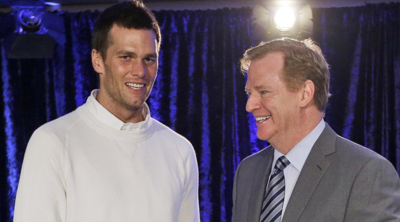 FILE - In this Feb. 2, 2015, file photo, New England Patriots quarterback Tom Brady poses with NFL Commissioner Rodger Goodell during a news conference after NFL football's Super Bowl XLIX in Phoenix, Ariz. Brady's appeal hearing is Tuesday, June 23, 2015