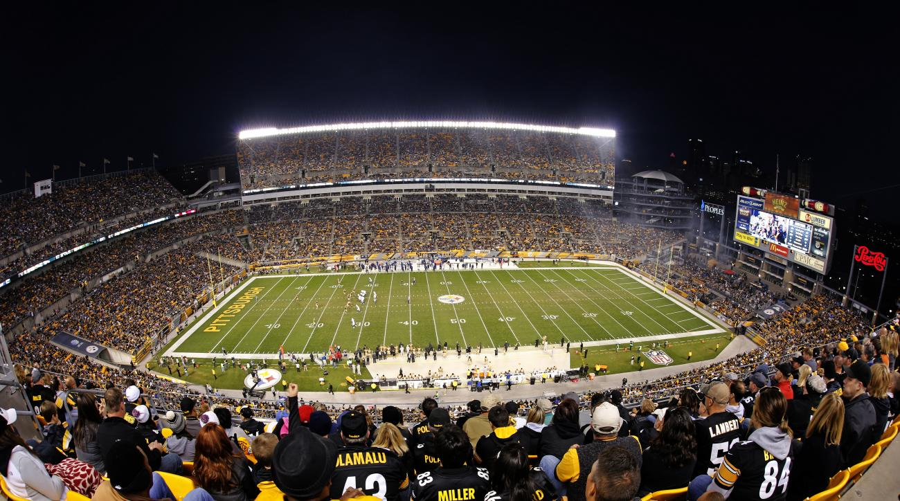 Football fans watch the second half of an NFL football game between the Pittsburgh Steelers and the Indianapolis Colts at Heinz Field in Pittsburgh, Sunday, Oct. 26, 2014.The Steelers won 51-34. (AP Photo/Gene J. Puskar)