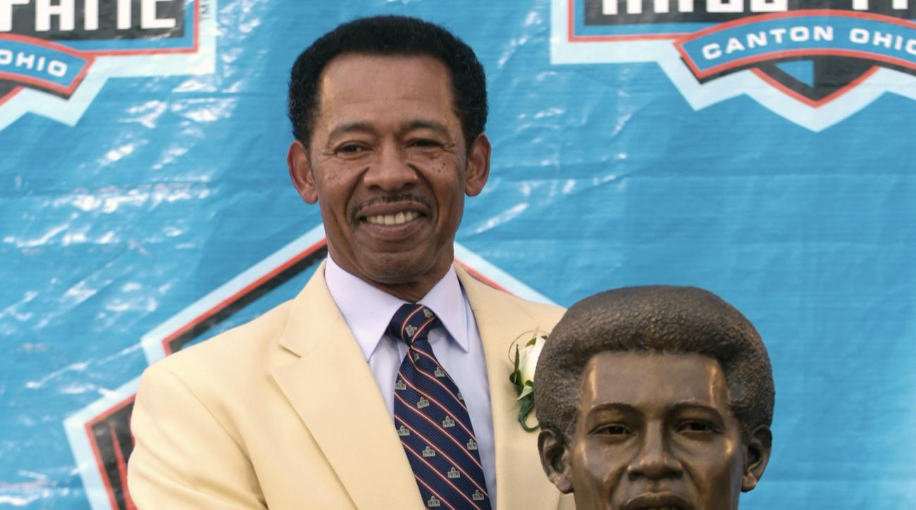 FILE - In this Saturday, Aug. 4, 2007 file photo, former Detroit Lions tight end Charlie Sanders stands with his bronze bust during the Pro Football Hall of Fame Induction Ceremony at the Pro Football Hall of Fame in Canton, Ohio. Sanders played 10 season