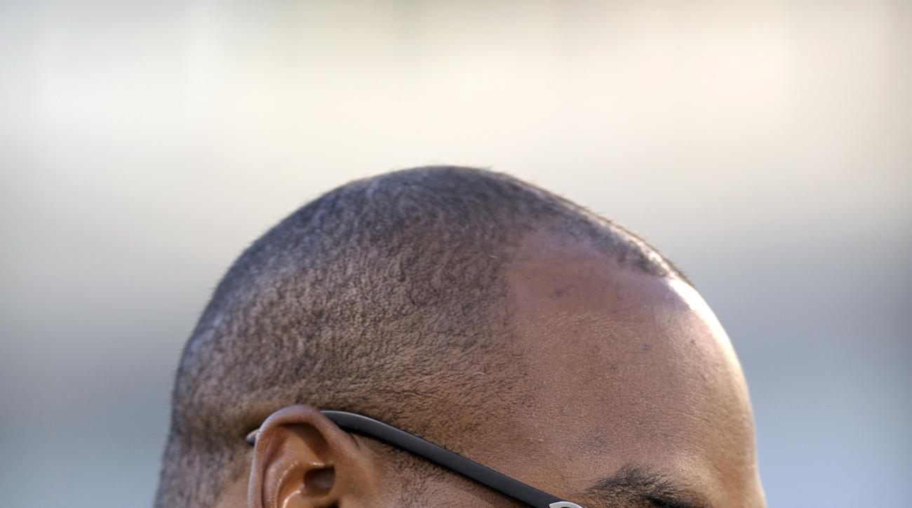 Former Philadelphia Eagles quarterback Donovan McNabb pauses during an interview before an NFL football game between the Philadelphia Eagles and the Kansas City Chiefs, Thursday, Sept. 19, 2013, in Philadelphia. McNabb is scheduled to have his jersey reti