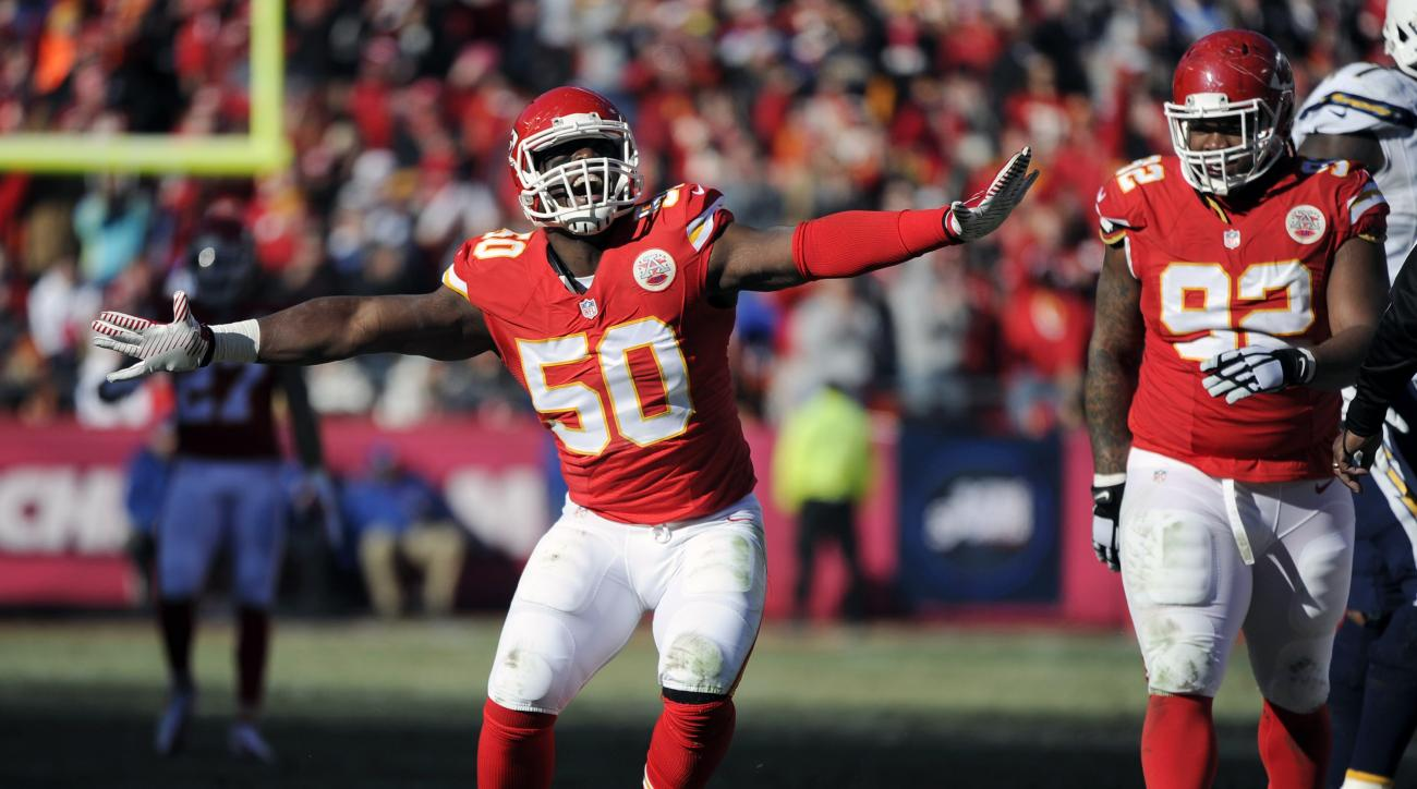 FILE - In this Dec. 28, 2014, file photo, Kansas City Chiefs outside linebacker Justin Houston (50) celebrates a sacking of San Diego Chargers quarterback Philip Rivers with Chiefs nose tackle Dontari Poe (92) looking on during the first half of an NFL fo