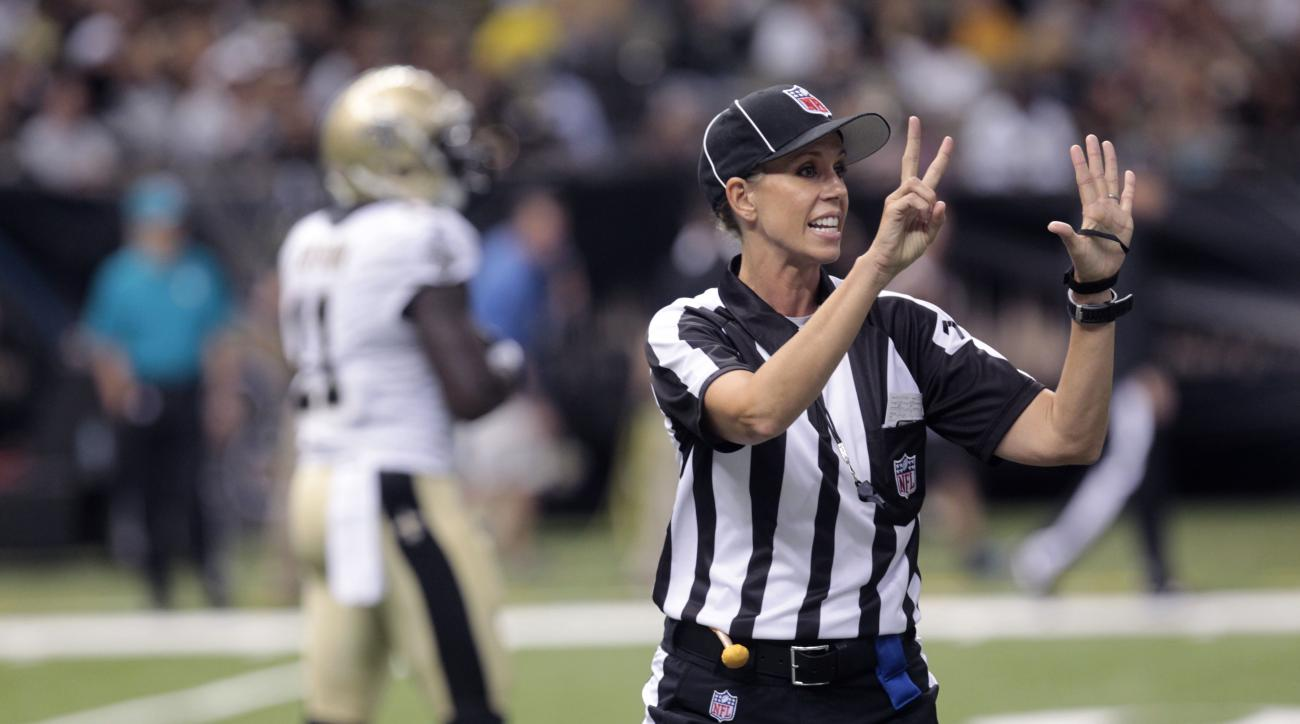 FILE - In this Aug. 16, 2013, file photo, NFL referee Sarah Thomas works the game in the second half of an NFL preseason football game between the New Orleans Saints and the Oakland Raiders at the Mercedes-Benz Superdome in New Orleans. Sarah Thomas is th