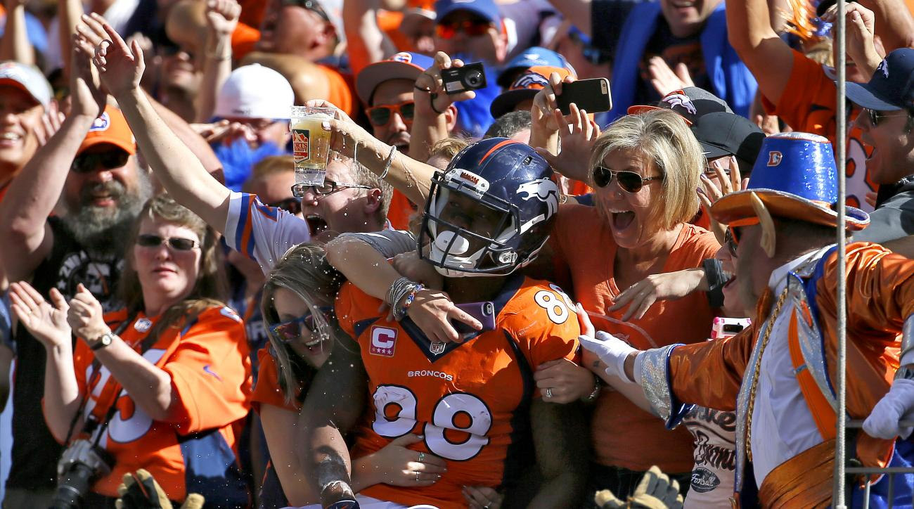 FILE - In this Oct. 5, 2014, file photo, Denver Broncos wide receiver Demaryius Thomas (88) celebrates his touchdown against the Arizona Cardinals with fans during the first half of an NFL football game in Denver. Demaryius Thomas is the highest-paid play