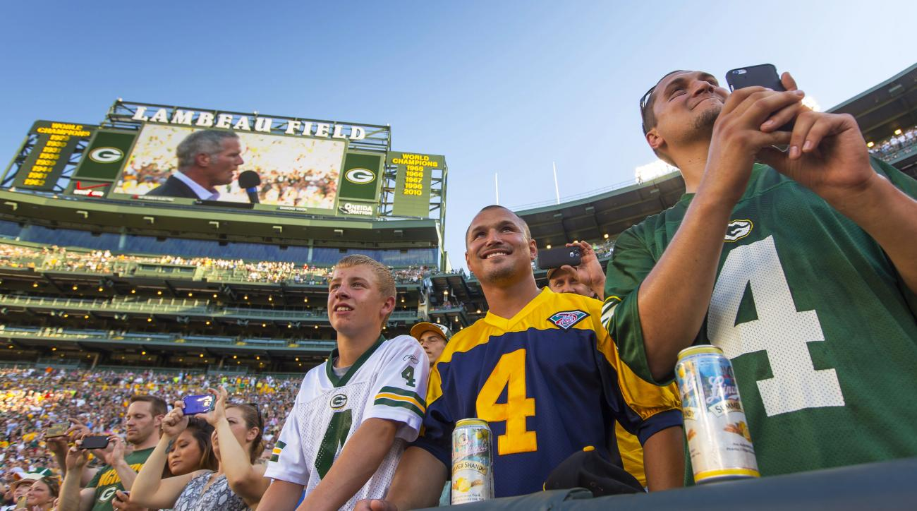 Fans watch former Green Bay Packers quarterback Brett Favre give a speech at Lambeau Field prior to his induction to the Packers Hall of Fame and having his No. 4 jersey retired, Saturday, July 18, 2015. in Green Bay, Wis. (AP Photo/Mike Roemer)