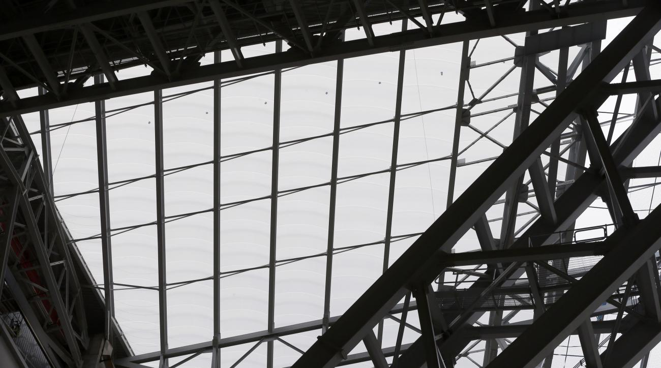 In this photo taken Thursday, July 16, 2015, see-through, lightweight EFTE roof panels at the new Minnesota Vikings NFL football stadium that is under construction in Minneapolis are shown. The architect chose the alternative roof that will let the light