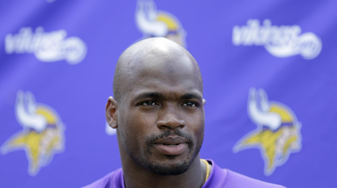 Minnesota Vikings running back Adrian Peterson answers a question after NFL football minicamp in Eden Prairie, Minn., Thursday, June 18, 2015. (AP Photo/Ann Heisenfelt)