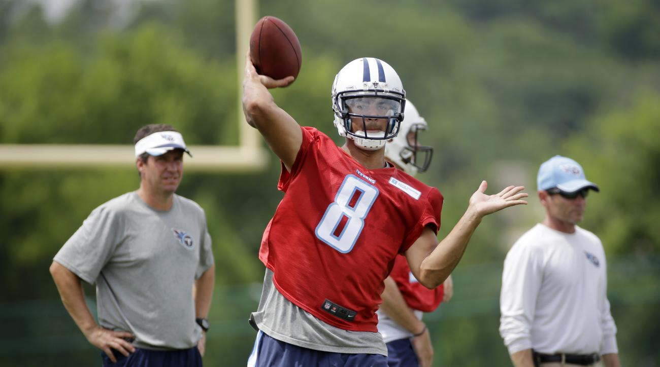 Tennessee Titans quarterback Marcus Mariota (8) passes during NFL football minicamp on Thursday, June 18, 2015, in Nashville, Tenn. (AP Photo/Mark Humphrey)