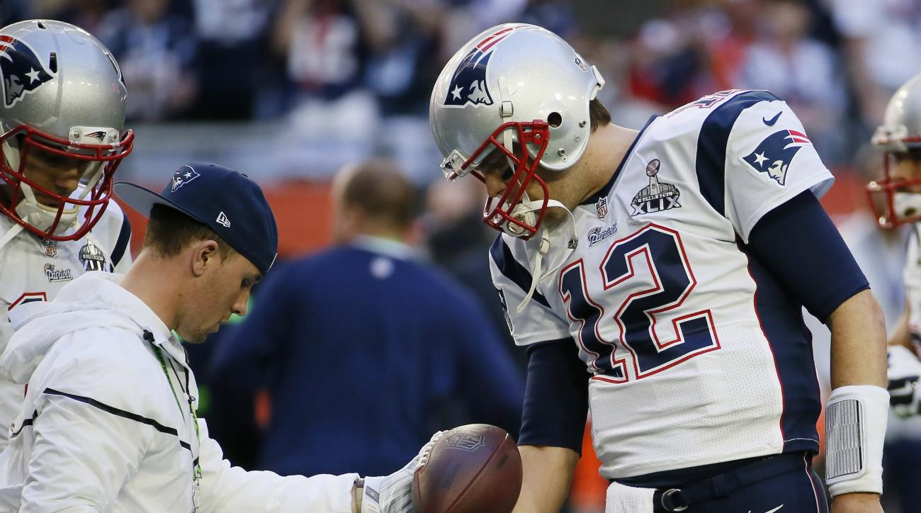 FILE - In this Feb. 1, 2015, file photo, New England Patriots quarterback Tom Brady (12) warms up before the NFL Super Bowl XLIX football game against the Seattle Seahawks in Glendale, Ariz. The players' union has proposed a settlement on Brady's four-gam