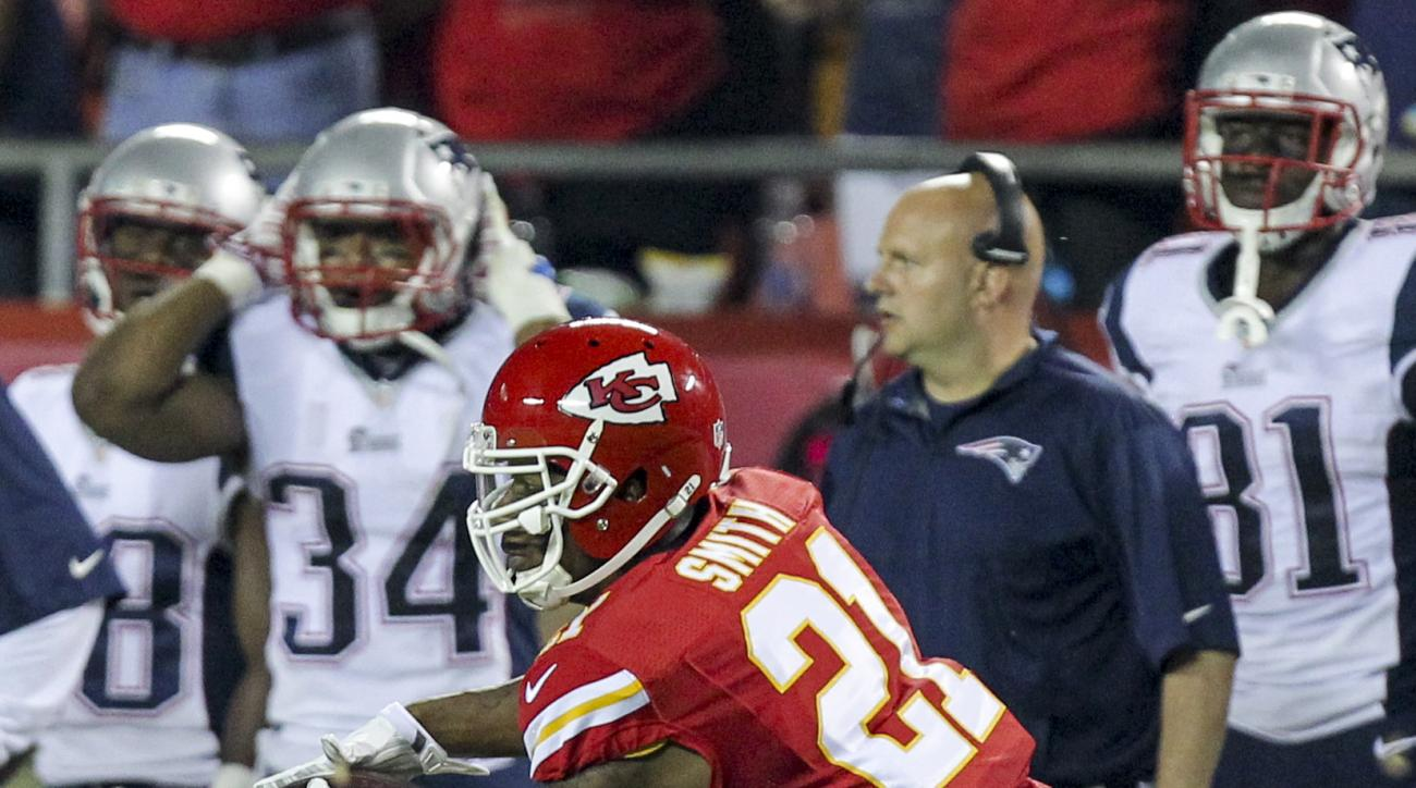 FILE - In this Sept. 29, 2014, file photo, Kansas City Chiefs cornerback Sean Smith intercepts a pass during the third quarter of an NFL football game in Kansas City, Mo., as New England Patriots running back Shane Vereen (34) reacts on the sidelines. Chi
