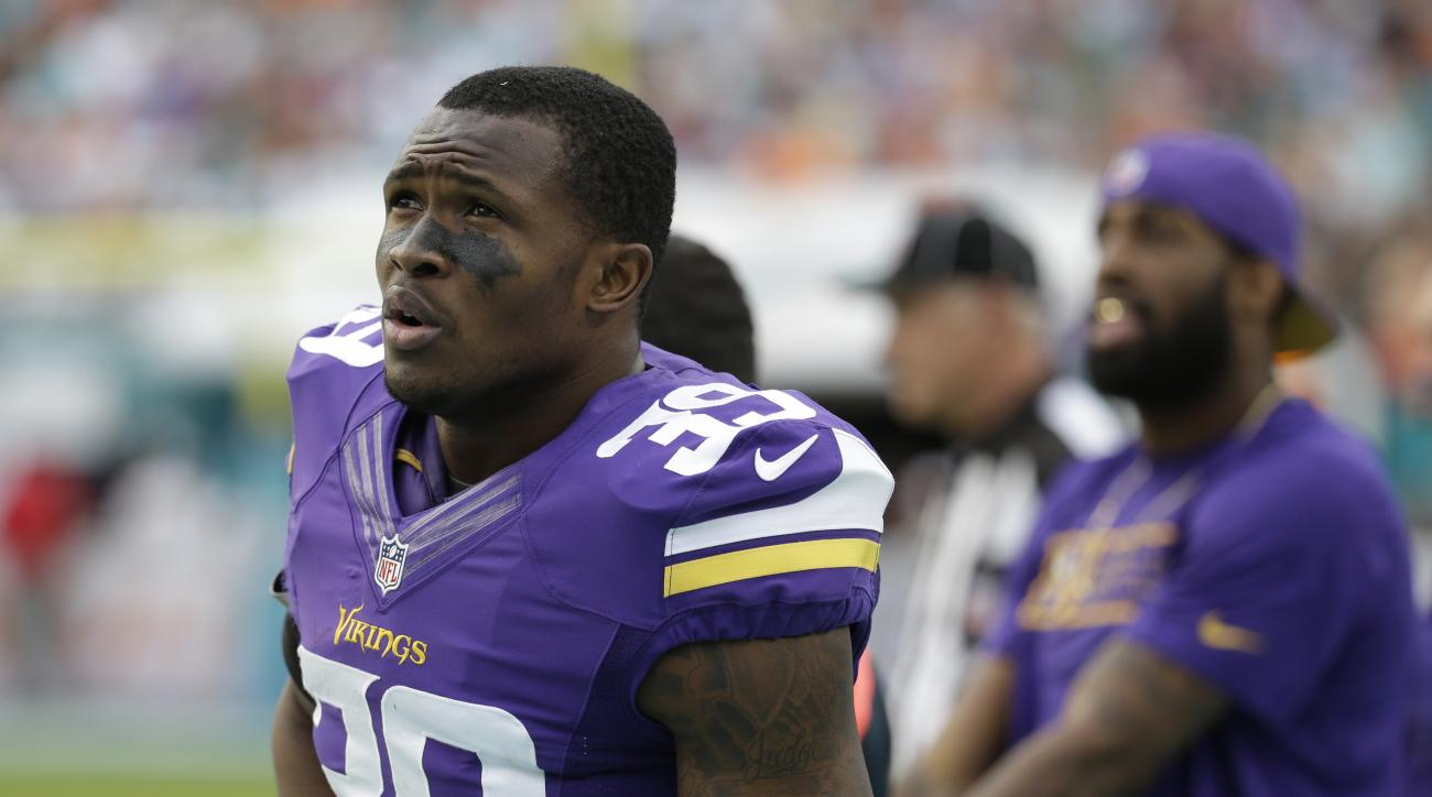 Minnesota Vikings cornerback Jabari Price (39) looks up during the second half of an NFL football game against the Miami Dolphins, Sunday, Dec. 21, 2014, in Miami Gardens, Fla. The Dolphins defeated the Vikings 37-35. (AP Photo/Lynne Sladky)