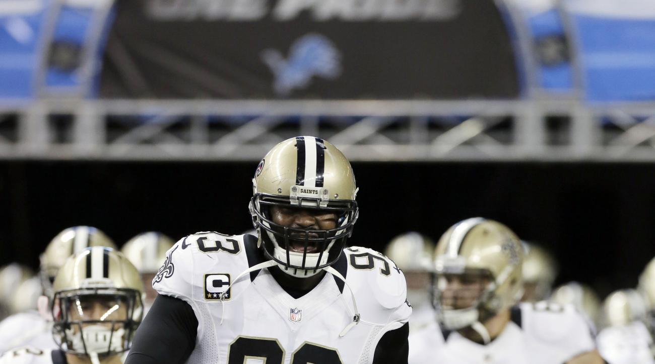 FILE - In this  Sunday, Oct. 19, 2014 file photo, New Orleans Saints outside linebacker Junior Galette (93) leads the team on to the field for an NFL football game against the Detroit Lions in Detroit. The New Orleans Saints have cut Junior Galette, who h