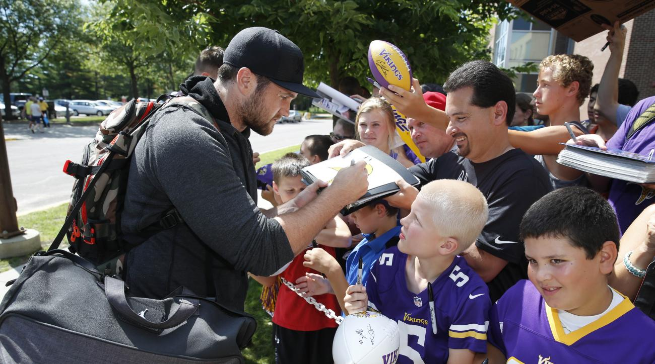 Minnesota Vikings linebacker Casey Matthews signs autographs as he reports to an NFL football training camp on the campus of Minnesota State University, Saturday, July 25, 2015, in Mankato, Minn. (AP Photo/Charles Rex Arbogast)