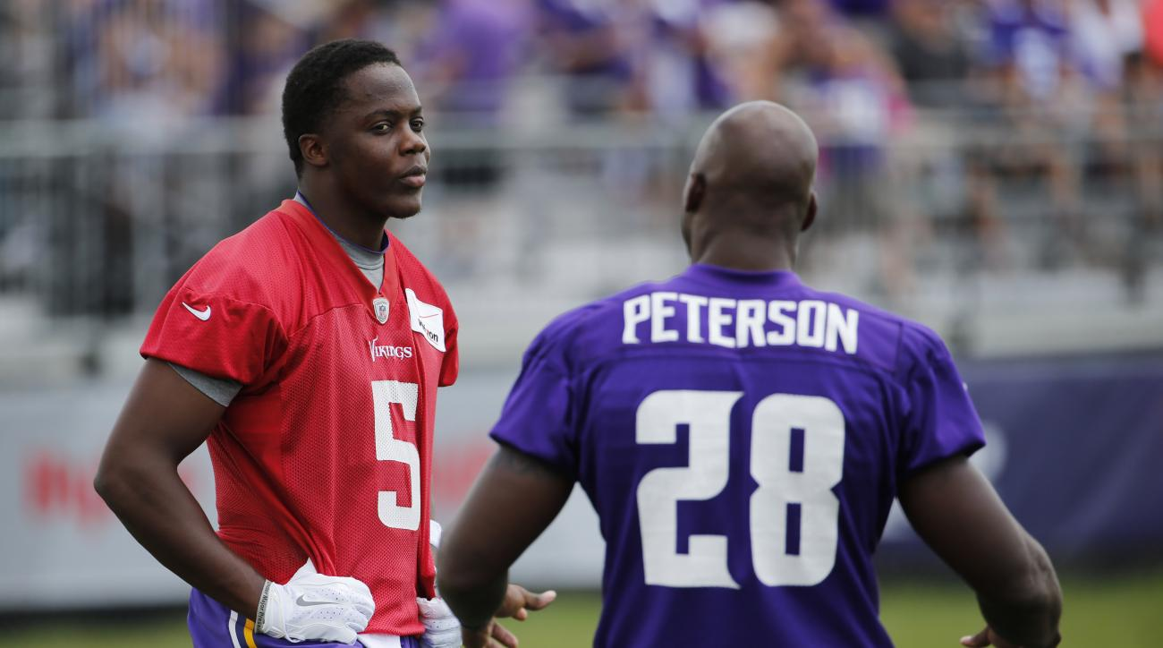 Minnesota Vikings quarterback Teddy Bridgewater (5) talks with running back Adrian Peterson before an afternoon practice session at an NFL football training camp on the campus of Minnesota State University, Sunday, July 26, 2015, in Mankato, Minn. (AP Pho