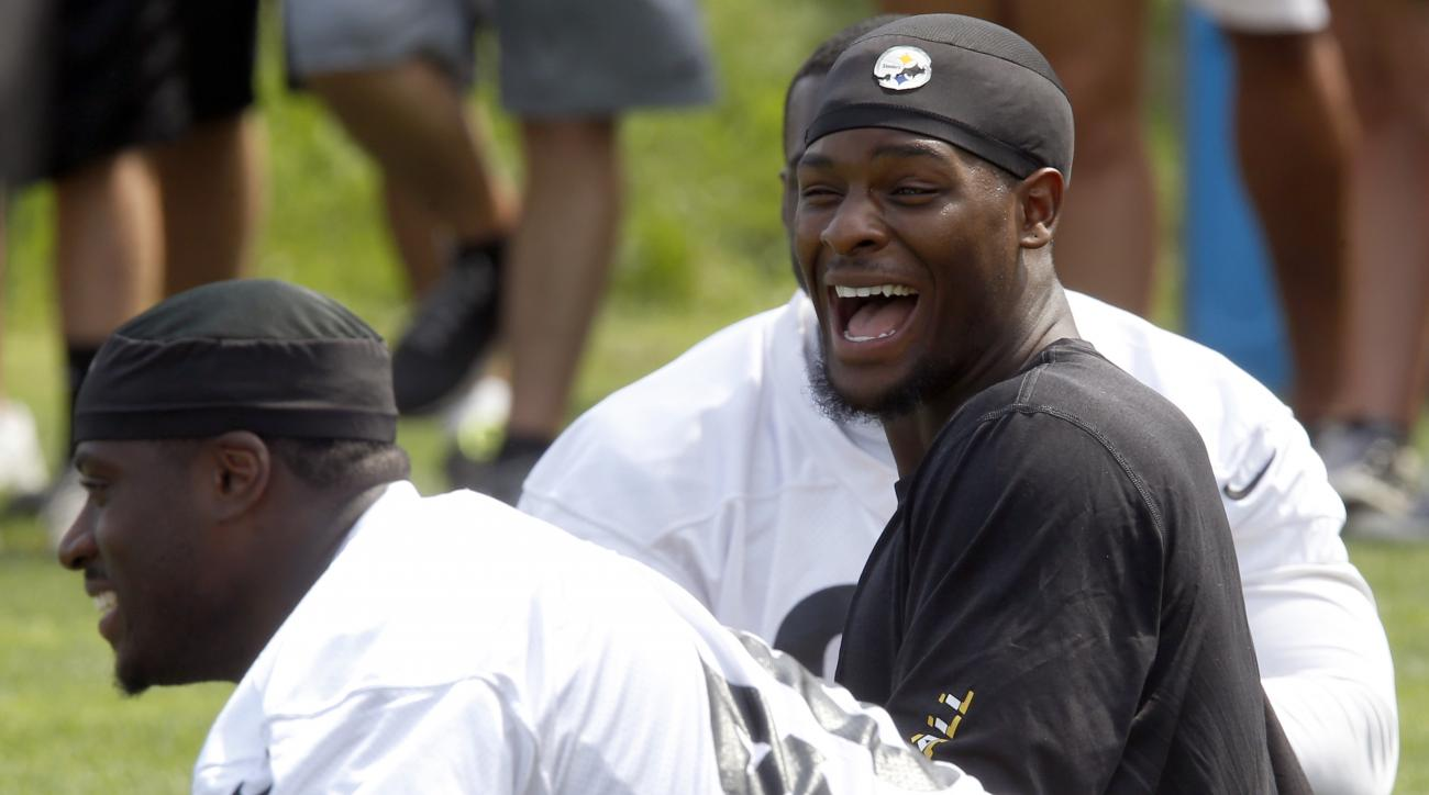 Pittsburgh Steelers running back Le'Veon Bell, right, has a laugh with fullback Will Johnson as the two stretch during practice at NFL football training camp in Latrobe, Pa. on Sunday, July 26, 2015 . (AP Photo/Keith Srakocic)