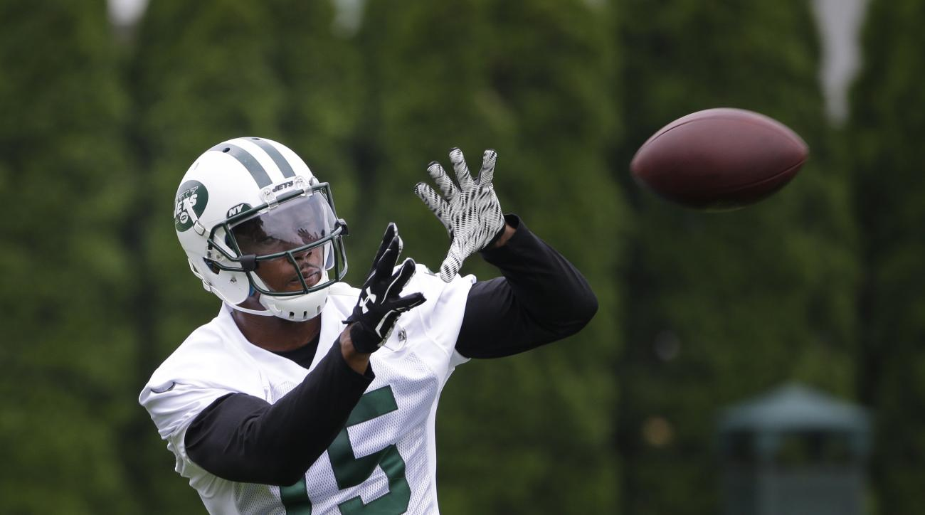 FILE - In this May 27, 2015, file photo, New York Jets' Brandon Marshall catches a pass during an NFL football organized team activity in Florham Park, N.J. General manager Mike Maccagnan kicked off an aggressive off season by acquiring wide receiver Bran