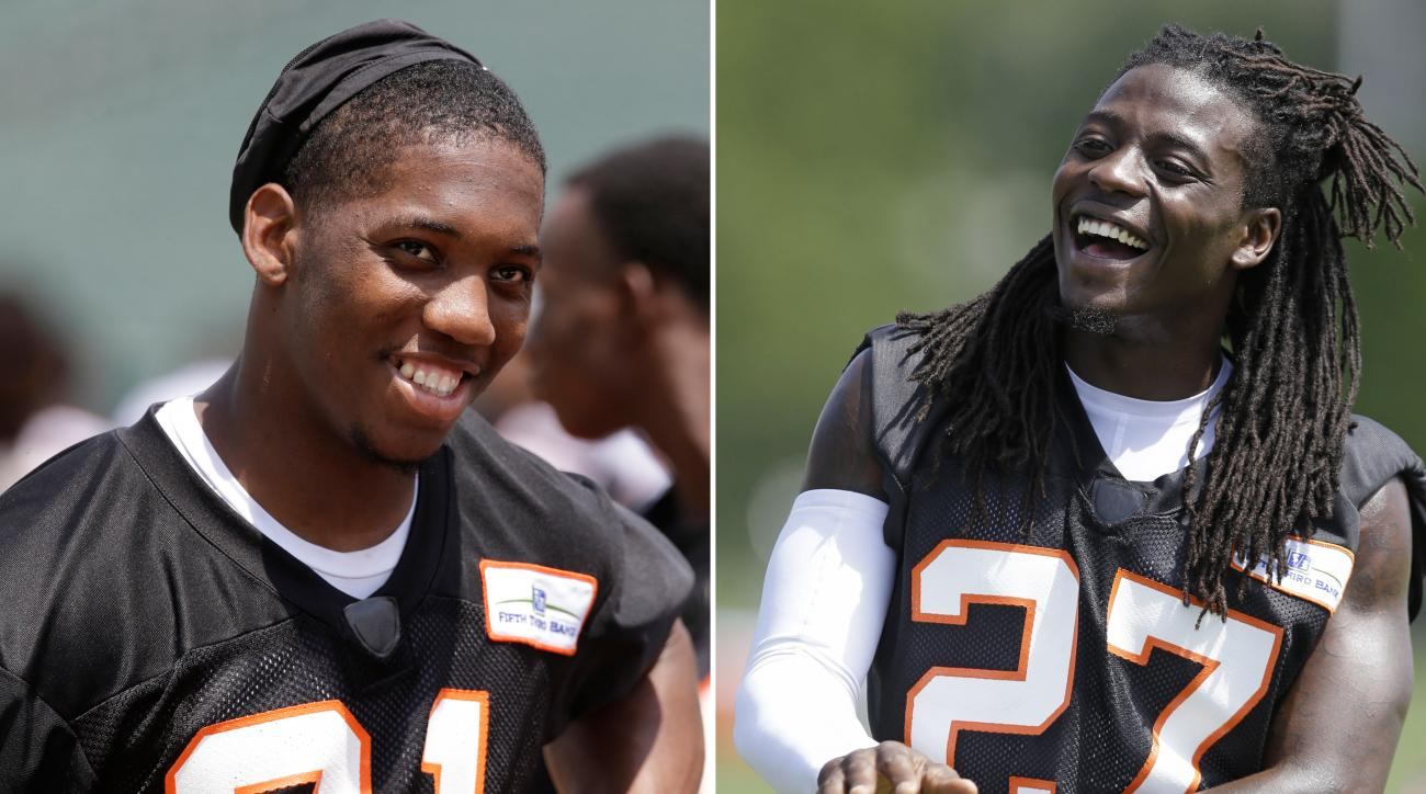 FILE - At left, in a June 3, 2014, file photo, Cincinnati Bengals' Darqueze Dennard walks off the field after an NFL football organized team activity in Cincinnati. At right, in a July 25, 2014, file photo, Bengals' Dre Kirkpatrick loosens up during the N