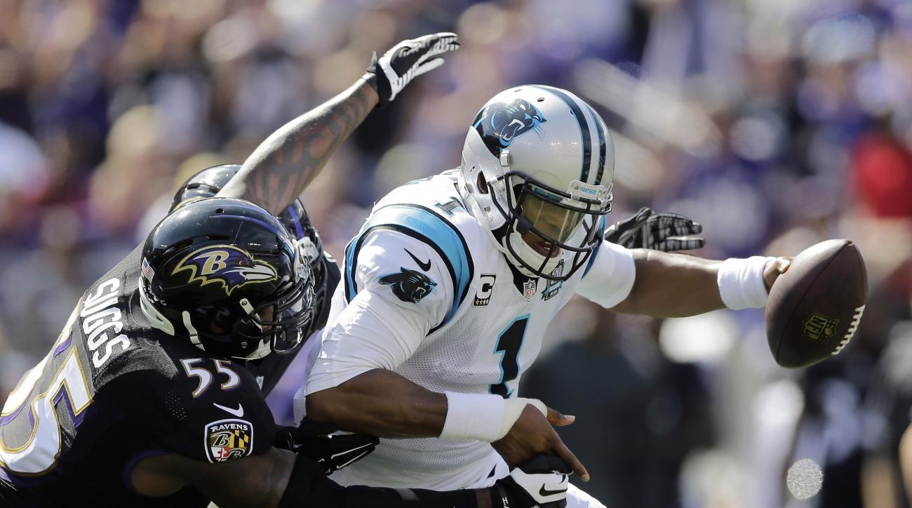 FILE - In this Sept. 28, 2014, file photo, Carolina Panthers quarterback Cam Newton (1) is sacked by Baltimore Ravens outside linebacker Terrell Suggs (55) during the first half of an NFL football game in Baltimore. (AP Photo/Patrick Semansky, File)