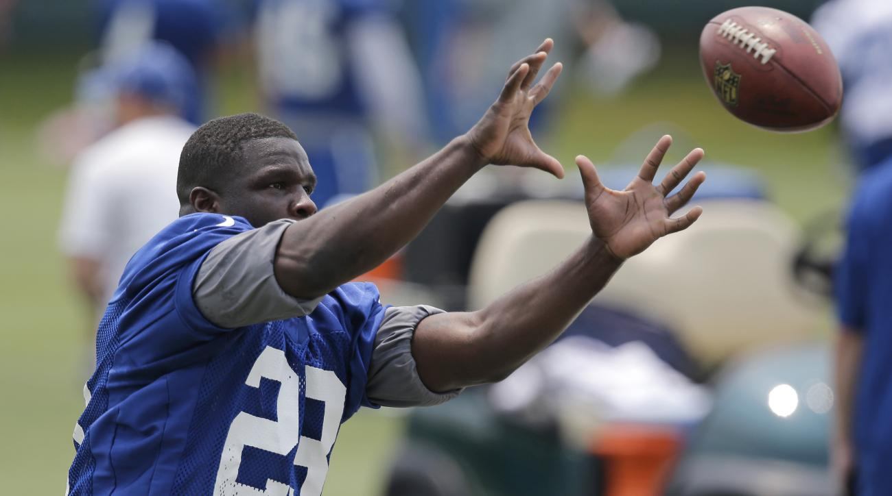 FILE - In this June 9, 2015, file photo, Indianapolis Colts running back Frank Gore makes a catch during an organized team activity at the NFL football team's practice facility in Indianapolis. This year, the Colts think they may have found the answer to