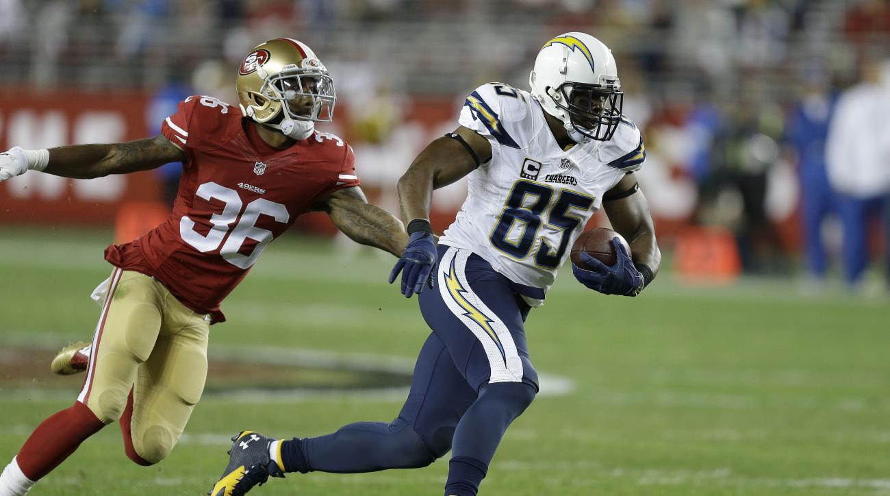 FILE - In this Saturday, Dec. 20, 2014, file photo, San Diego Chargers tight end Antonio Gates (85) runs past San Francisco 49ers defensive back Dontae Johnson (36) during the first half of an NFL football game in Santa Clara, Calif. Star tight end Antoni