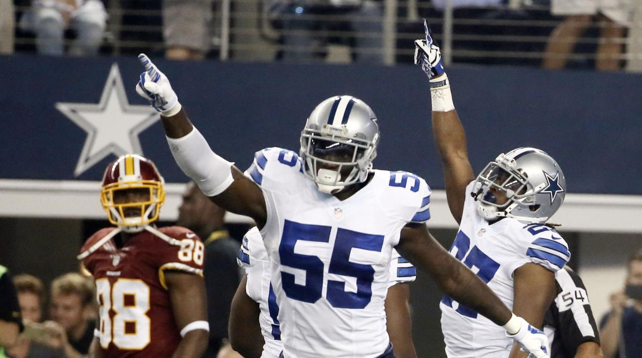 FILE - In this Monday, Oct. 27, 2014 file photo, Dallas Cowboys' Rolando McClain (55) and J.J. Wilcox (27) celebrate an interception by Wilcox as Washington Redskins' Pierre Garcon (88) watches during the first half of an NFL football game in Arlington, T