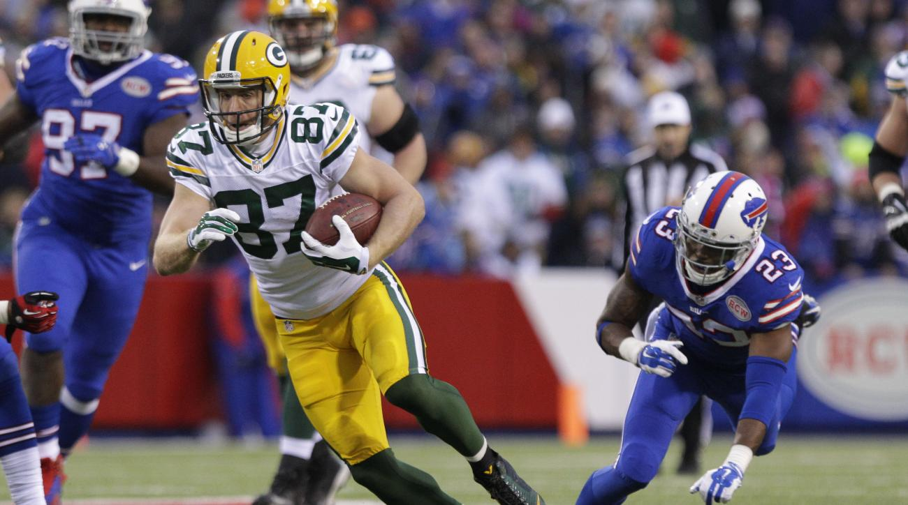 FILE - In this Sunday, Dec. 14, 2014 file photo, Green Bay Packers' Jordy Nelson (87) breaks a tackle by Buffalo Bills' Aaron Williams (23) during the second half of an NFL football game in Orchard Park, N.Y. (AP Photo/Bill Wippert, File)