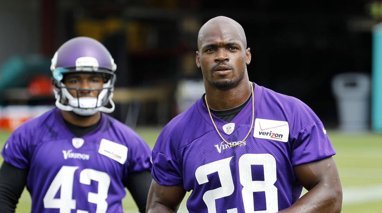 FILE - In this Wednesday, June 17, 2015,  file photo, Minnesota Vikings running back Adrian Peterson (28) walks across the field during NFL football minicamp in Eden Prairie, Minn. The sideshow that overshadowed last season has been dismantled, following