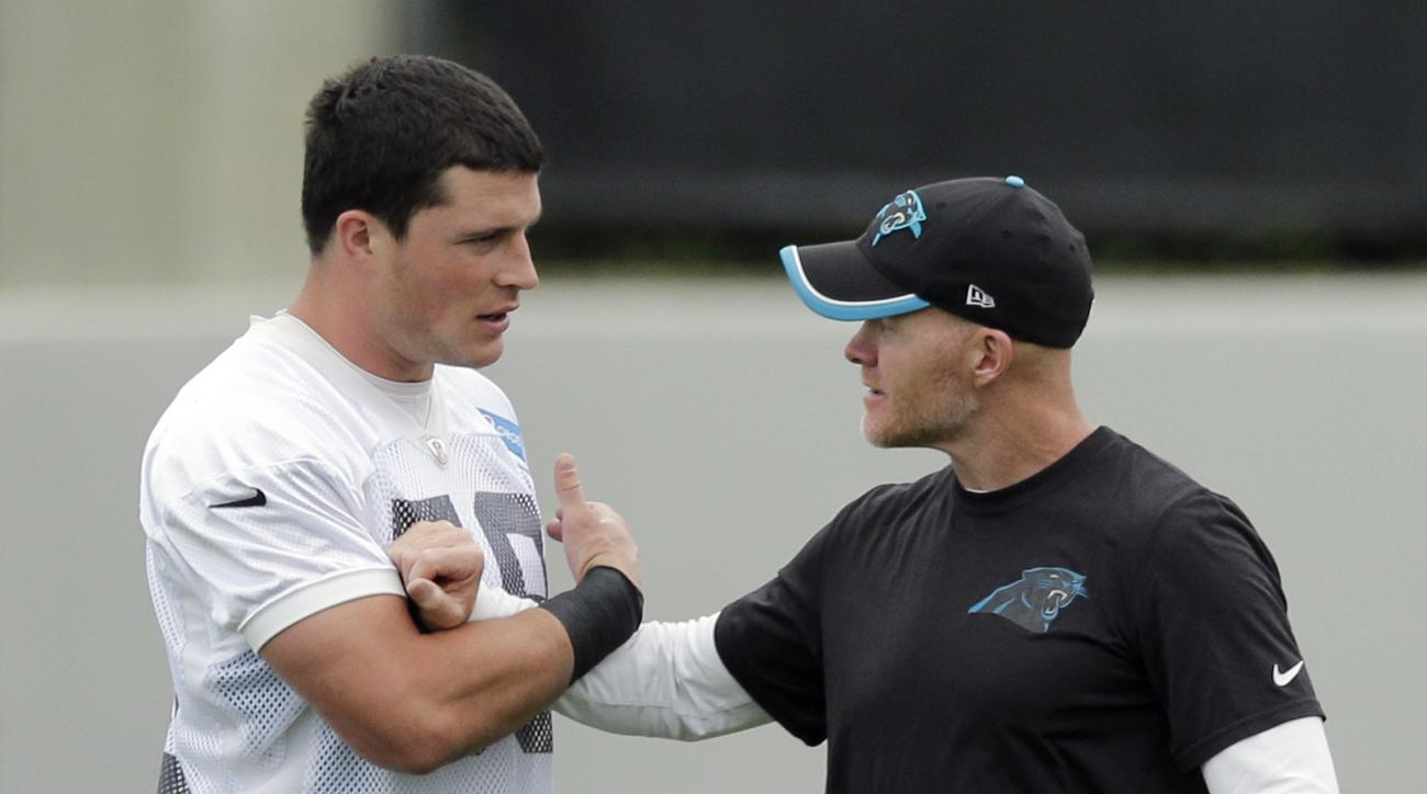 FILE - In this June 4, 2015, file photo, Carolina Panthers' Luke Kuechly, left, talks with defensive coordinator Sean McDermott during an NFL football organized team activity in Charlotte, N.C. Carolina's defense has finished in the top 10 the last three