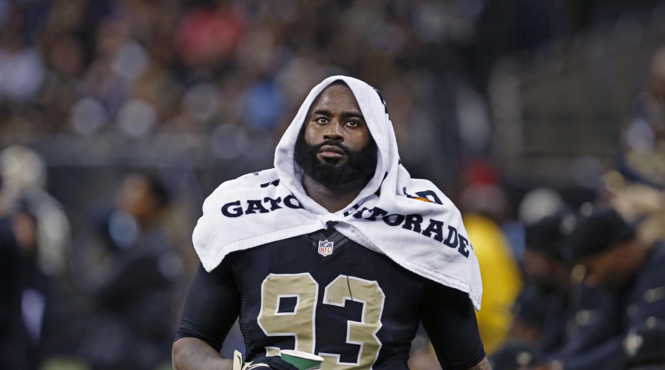 FILE - In this Nov. 24, 2014, file photo, New Orleans Saints outside linebacker Junior Galette walks along the bench during an NFL football game against the Baltimore Ravens in New Orleans.A defense that ranked second-to-last in the NFL last season has cu