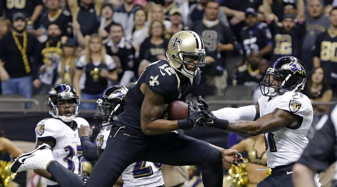 FILE - In this Nov. 24, 2014, file photo, New Orleans Saints wide receiver Marques Colston (12) pulls in a touchdown reception in front of Baltimore Ravens strong safety Matt Elam, middle rear, and free safety Terrence Brooks, right, during an NFL footbal