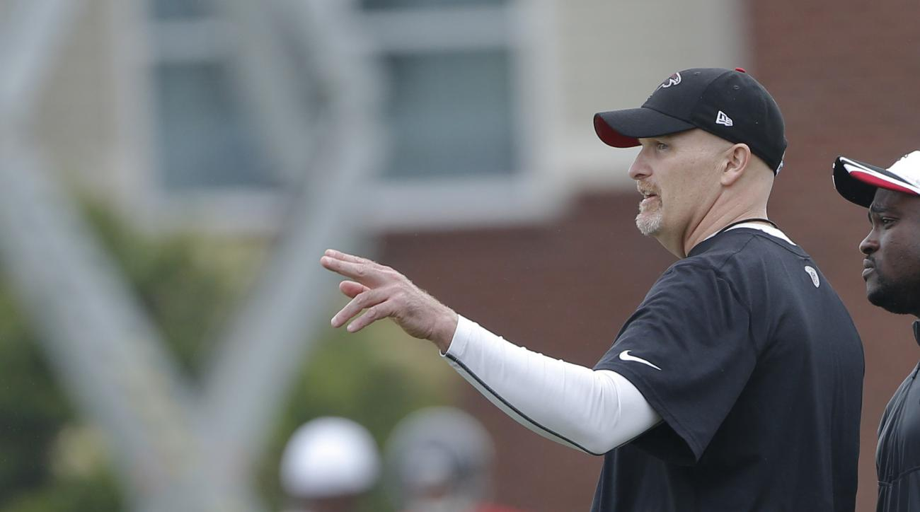 FILE - In this May 26, 2015, file photo. Atlanta Falcons coach Dan Quinn gestures during the NFL football team's training session in Flowery Branch, Ga. Quinn, who as defensive coordinator helped lead Seattle to two straight Super Bowls, including one cha