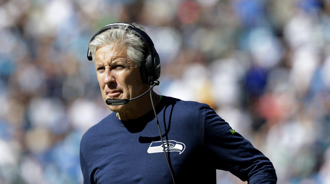 FILE - In this Oct. 26, 2014, file photo, Seattle Seahawks head coach Pete Carroll walks on the sidelines during the first half of an NFL football game against the Carolina Panthers in Charlotte. (AP Photo/Bob Leverone, File)