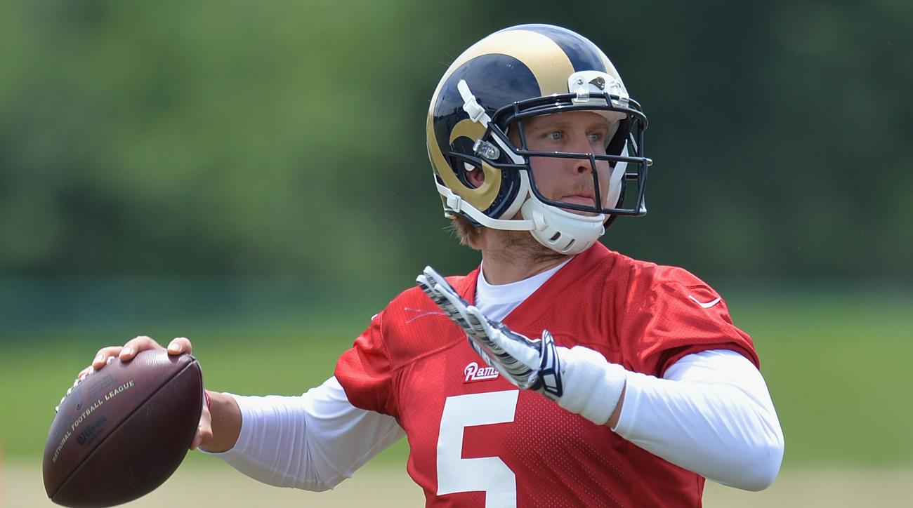 FILE - In this June 11, 2015, file photo, St. Louis Rams quarterback Nick Foles throws a pass during an NFL football organized team activity in St. Louis. (AP Photo/Michael Thomas)