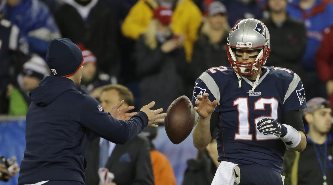 FILE - In this Jan. 18, 2015, file photo, New England Patriots quarterback Tom Brady has a ball tossed to him during warmups before the NFL football AFC Championship game against the Indianapolis Colts in Foxborough, Mass. Brady's four-game suspension for