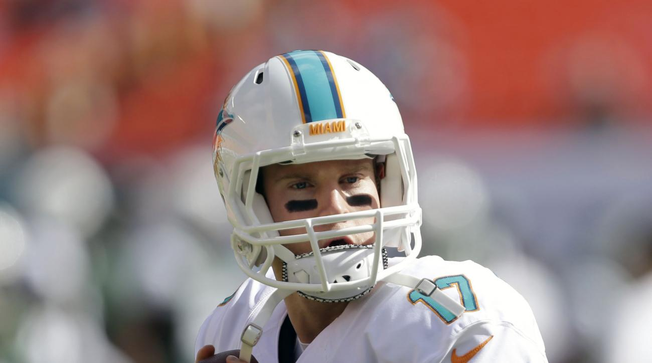 FILE - In this Sunday, Dec. 28, 2014 file photo, Miami Dolphins quarterback Ryan Tannehill (17) warms up before an NFL football game against the New York Jets, in Miami Gardens, Fla.  The pontificating and prognosticating that have always swirled around t